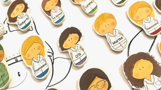 Covid nurses wear lapel pins with cartoon avatar
